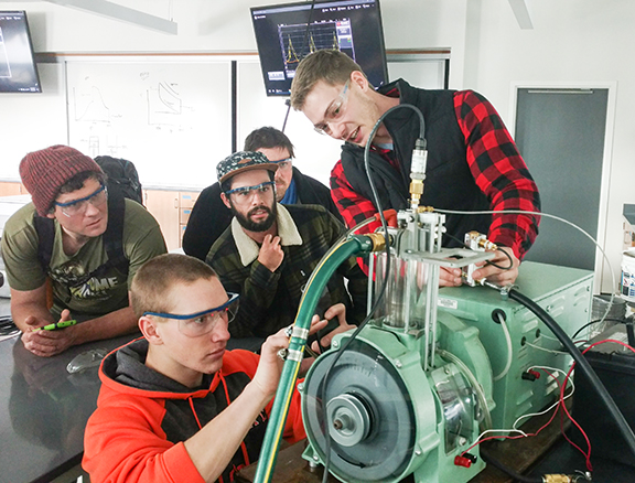 PhD student Shane Daly conducting an internal combustion engine demonstration